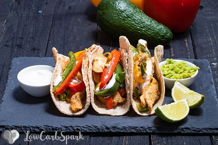 These Easy Chicken Fajitas are healthy, quick to make and perfect for a weeknight dinner. The chicken is succulent, super flavourful and the low carb tortillas are fantastic. Enjoy this one-pan meal made with peppers, onions, chicken spicy fajita seasoning.