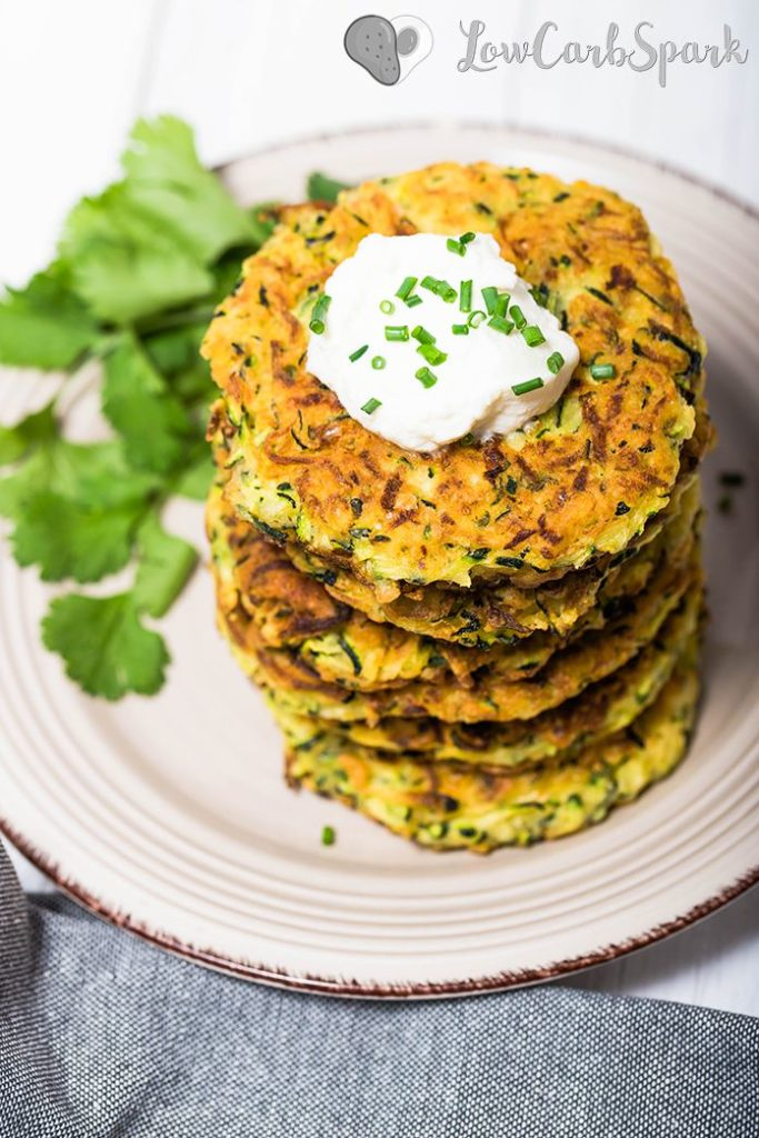 Zucchni Fritters topped with a dollop of sour cream and chives