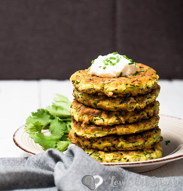 These zucchini fritters are extremely easy to make, low in carbs and family friendly. Keto zucchini pancakes that are delicious served warm with sour cream, fantastic for meal prep and perfect snack for summer.