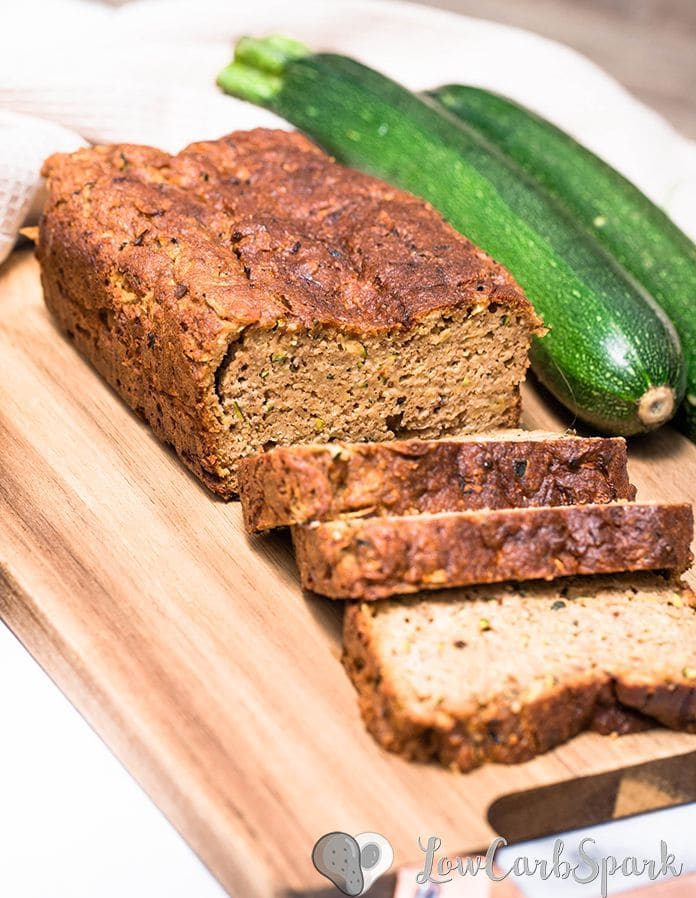 The easiest keto zucchini bread recipe! It's super moist, perfectly spiced and low in carbs bread with grated zucchini, cinnamon, nutmeg, and optional walnuts or pecans. #ketobread #zucchini #zucchinibread #paleo #keto