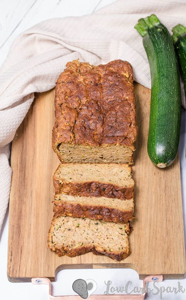 The easiest keto zucchini bread recipe! It's super moist, perfectly spiced and low in carbs bread with grated zucchini, cinnamon, nutmeg, and optional walnuts or pecans. #ketobread #zucchinibread