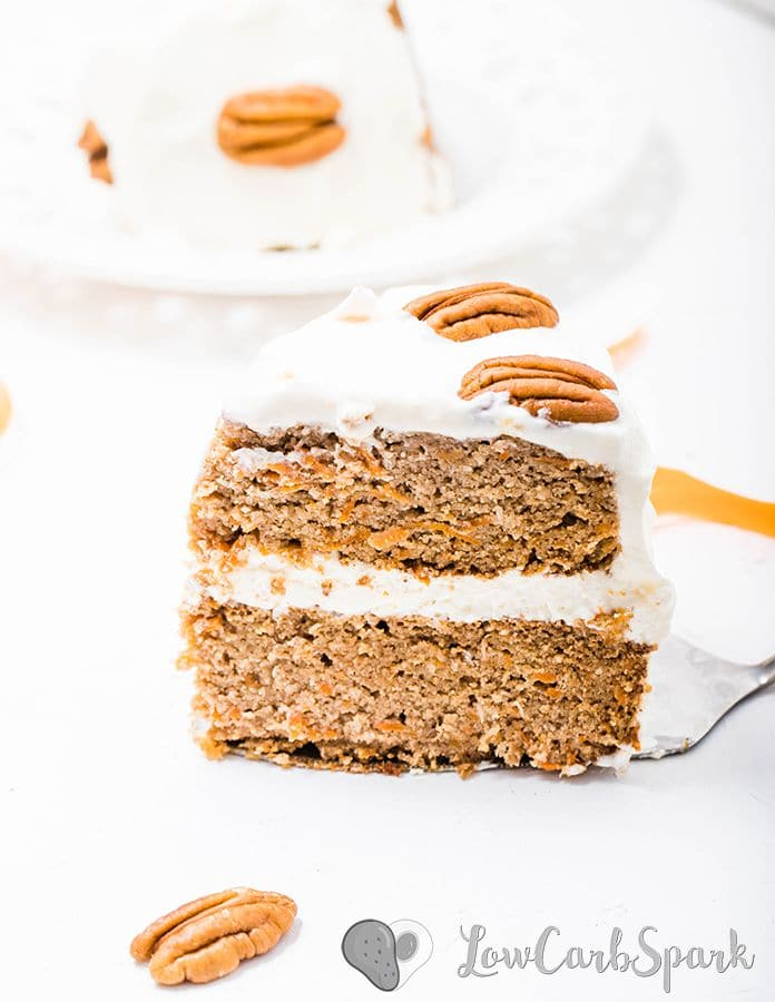 a keto carrot cake slice with sugar-free cream cheese frosting and pecans