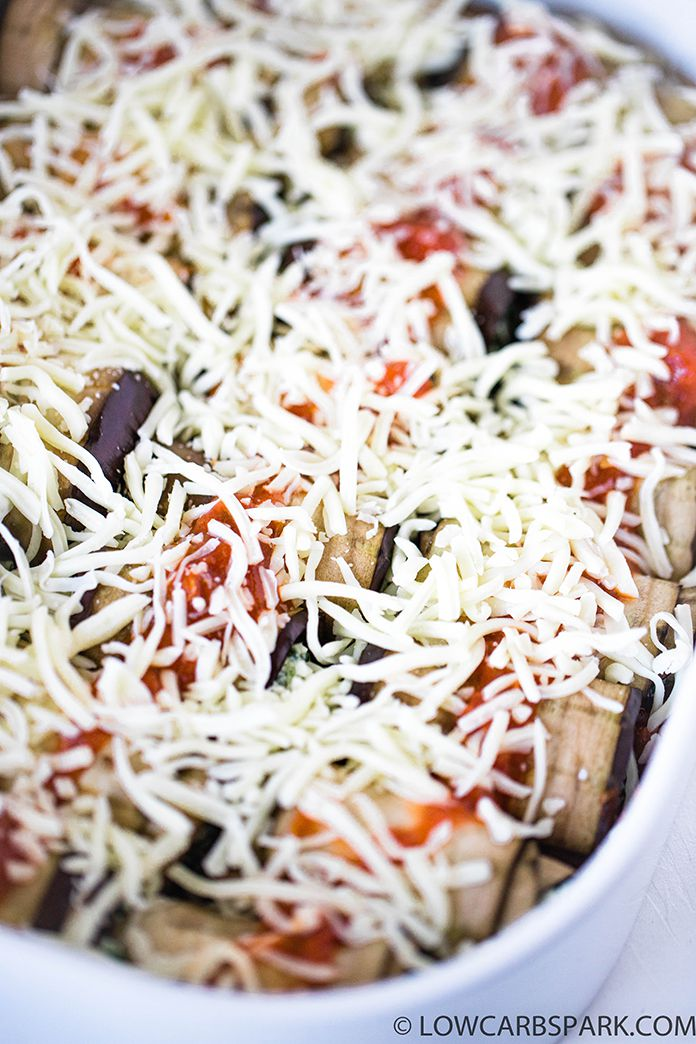 top the eggplant rolls with marinara sauce and mozzarella