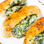 Delicious chicken breast stuffed with creamy and cheesy spinach, cream cheese filling baked in the oven is super juicy and tasty. This meal is family-friendly and super quick to make.