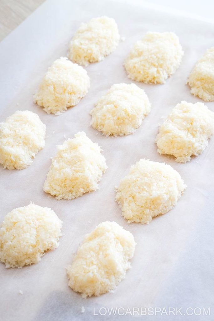 Form coconut bars using your hands.
