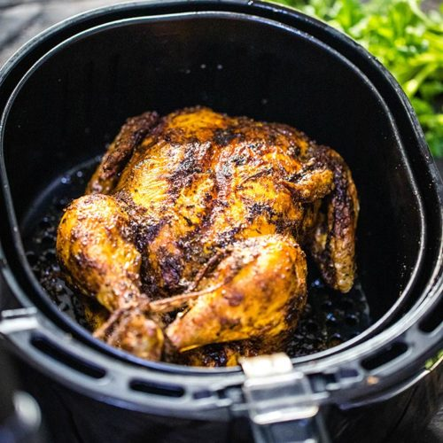 This AMAZING Air Fryer Whole Chicken recipe is so easy, and the result is incredible - juicy with irresistible crispy and tasty skin. With just a few ingredients and minimal preparation, you can enjoy perfectly cooked rotisserie chicken in under one hour.