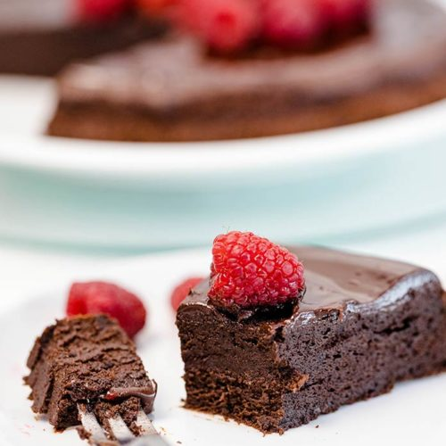 This decadent gluten-free flourless chocolate cake recipe is naturally keto and sugar-free. Make it for any special occasion when you want a sugar-free fudgy flourless cake.