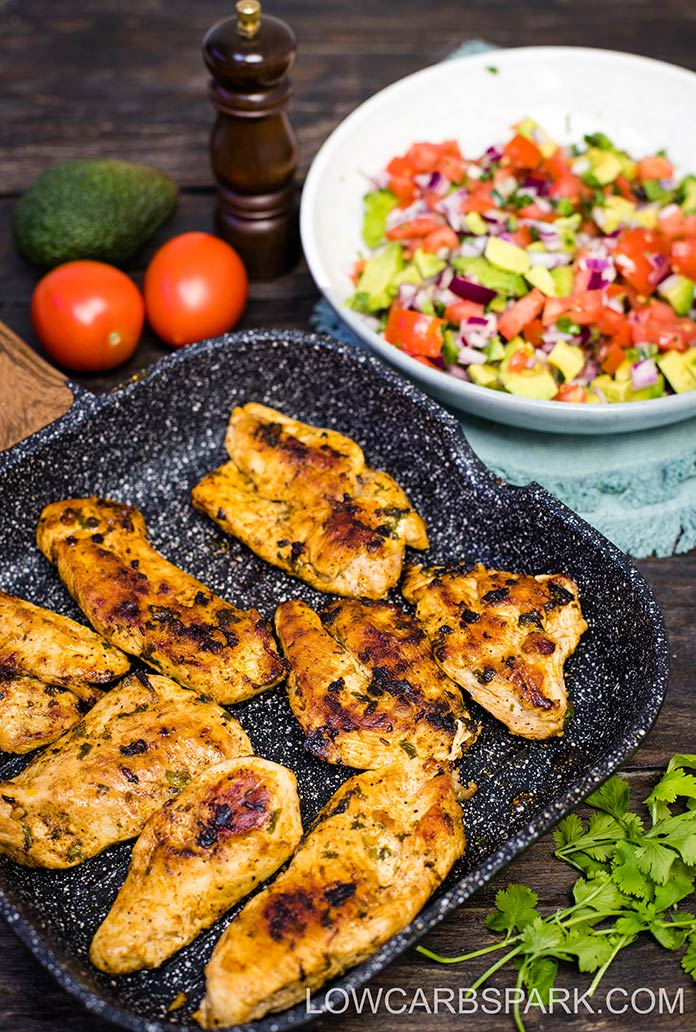 grilled lime chicken in a grill pan and avocado salsa