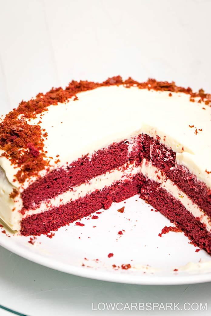layered keto red velvet cake with sugar free cream cheese frosting sections