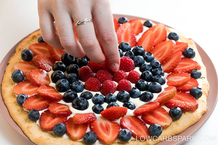 decorate keto pizza with fruits